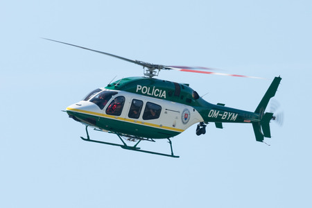 SLIAC, SLOVAKIA - AUGUST 30: Dynamic display of police Bell 429 helicopter at SIAF airshow in Sliac, Slovakia on August 30, 2015
