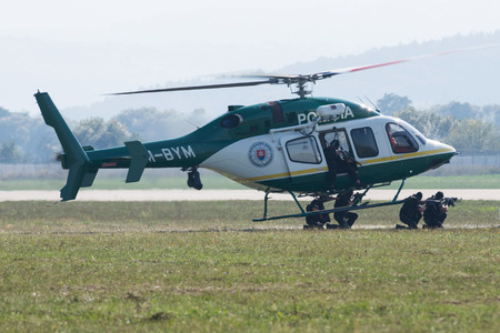 commando: SLIAC, SLOVAKIA - AUGUST 30: Dynamic display of police commando attack from Bell 429 helicopter at SIAF airshow in Sliac, Slovakia on August 30, 2015 Editorial
