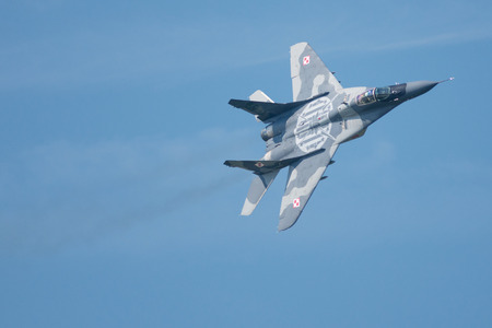 mig: SLIAC, SLOVAKIA - AUGUST 30: Flight of Mig 29 Fulcrum of Polish Air Forces at SIAF airshow in Sliac, Slovakia on August 30, 2015