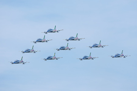 slovak: SLIAC, SLOVAKIA - AUGUST 30: Flight in close formation of Italian aerobatic team Frecce Tricolori at SIAF airshow in Sliac, Slovakia on August 30, 2015 Editorial