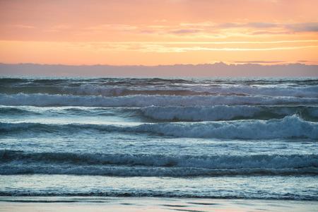 north island: Vibrant sunset above Tasman Sea seen from Nine Mile Beach, North Island, New Zealand