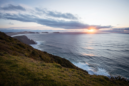 north island: Sunset above Tasman Sea seen from Cape Reinga, North Island, New Zealand