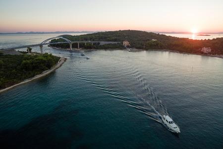 Mali Zdrelac bridge connecting Ugljan and Pasman islands during sunset