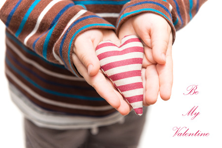 Striped heart in hands of little kid