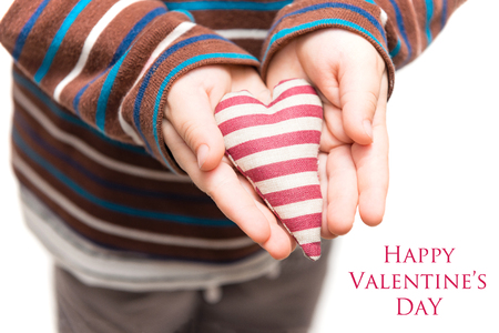 Valentine card - heart in hands of a kid