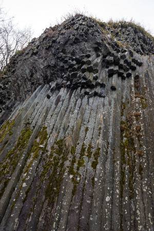 Rocky waterfall - Basaltic pentagonal columns - geological formation of volcanic origin near castle Somoska, Slovakia