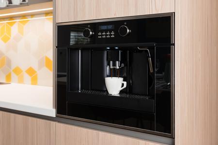 Built-in coffee machine in contemporary kitchen