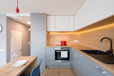 BRATISLAVA, SLOVAKIA - DEC 17, 2018: Kitchen area of small apartment designed by young interior designers from Kivvi architects based in Bratislava, Slovakia
