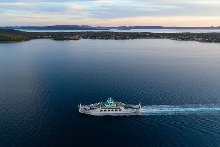 Aerial view of car ferry with Ugljan island in background at dusk, Croatia Stock Photo