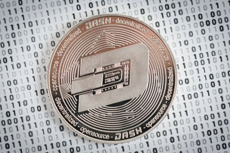 Crypto currency coin - silver Dash on binary background
