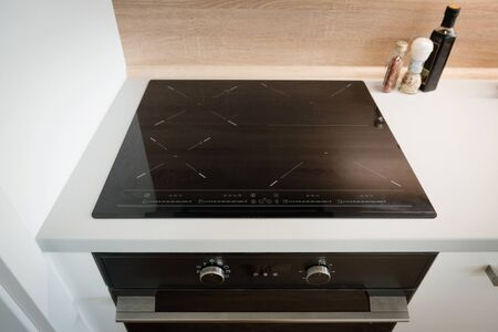 Electric stove with induction cooktop in contemporary kitchen
