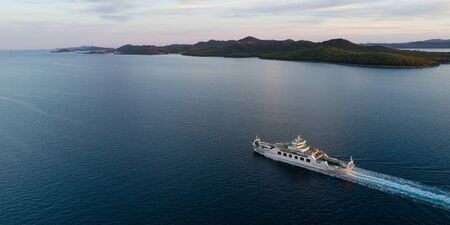 Aerial view of car ferry with Ugljan island in background at dusk, Croatia Imagens