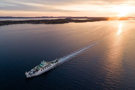Aerial view of car ferry near Zadar at sunset, Croatia