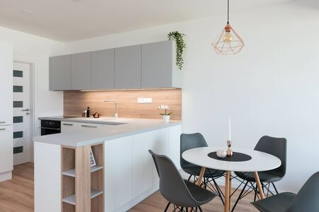 Interior of modern kitchen with dining table Foto de archivo