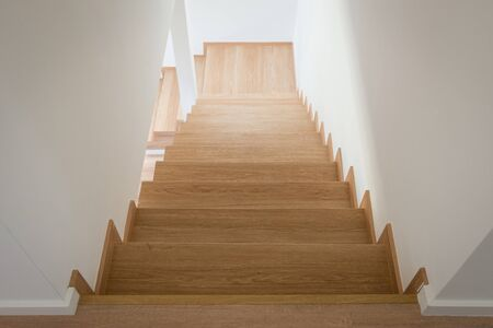 Wooden stairway in modern house from above