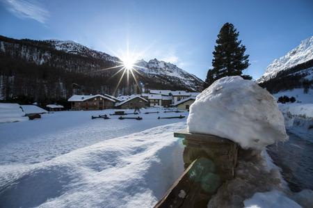 winter landscape with cross sun photo