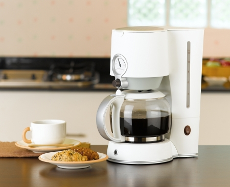 Enjoy your breakfast or coffee break with coffee maker and boiler machine photo