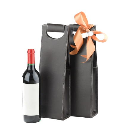 A luxury leather wine bag and wine bottle ready to gift to someone photo