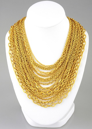 a lot of valuable gold necklaces photo