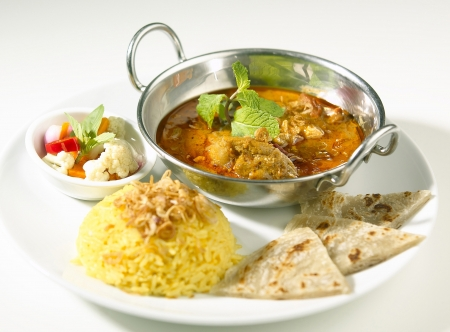 Indian curry served with rice and naan
