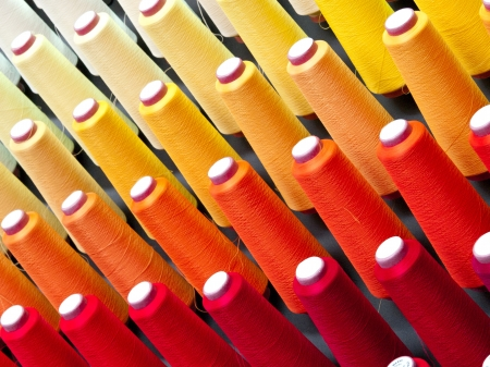 descriptive colors: The colorful of the cone threads from textile factory