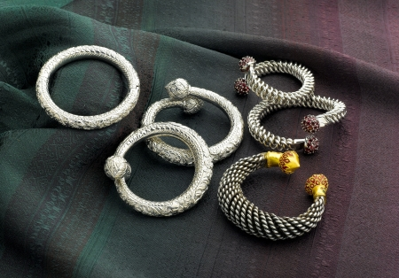 thailand silk: Silver and gold bracelets designed in Thai style Stock Photo