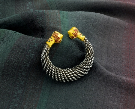 Silver bracelet decorated by golden photo