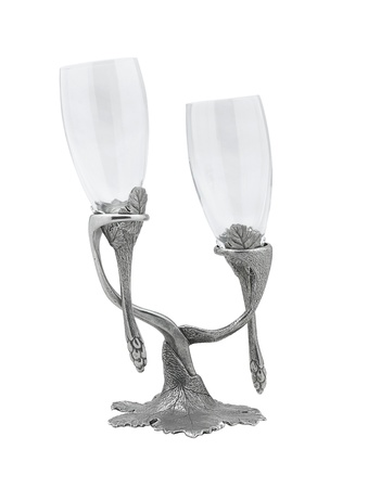 A pair of wine glasses hang on beautiful pewter stand Stock Photo - 16723860