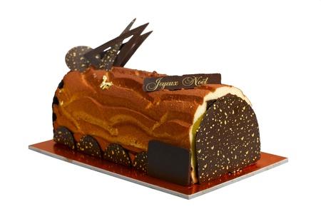weihnachtskuchen: Essbare Weihnachten log Schokoladenkuchen das hübsche Geschenk für dieses yule Lizenzfreie Bilder