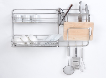 Stainless shelf with kitchen utensil on the white background Stock Photo