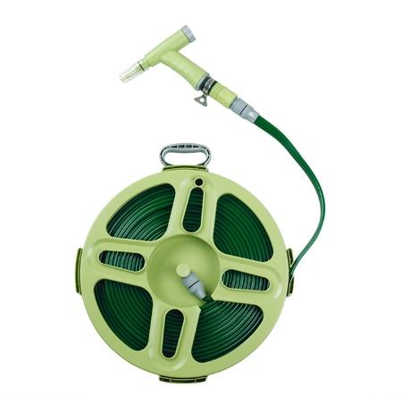 coiled: A green garden hose coiled with spray nozzle Stock Photo