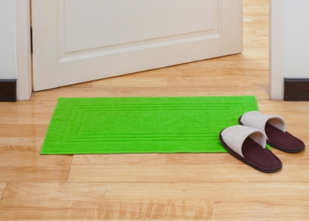 Green doormat help you clean your feet before come in home Stock Photo
