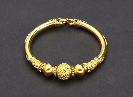 Golden bracelet designed by thai ancient goldsmith photo