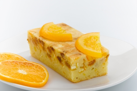 custard slices: Eatable cake topping with orange the good snack for your tea time Stock Photo