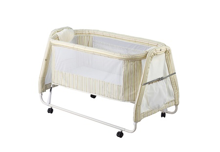 A cute baby cot with mosquito net photo