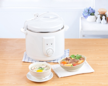 cooker: Rice cooking and electric casserole pot very importance kitchenware Stock Photo