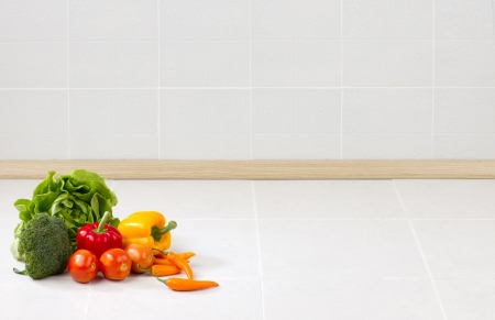 contemporary kitchen: Empty space on the counter in the kitchen with vegetables for putting text or your product on it Stock Photo