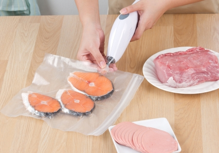 Keep your food always fresh by vacuum packing machine photo