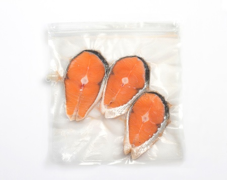Salmon in vacuum packing bag photo