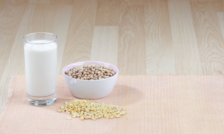 A glass of soy milk with a bowl of raw soybean and soybean seed Stock Photo - 16844885