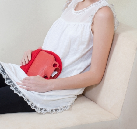 back packs: If you have abdominal pain by menstruation the hot pack can help you relieve the pain Stock Photo