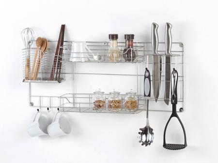 Stainless shelf with kitchen utensil on the white background Standard-Bild