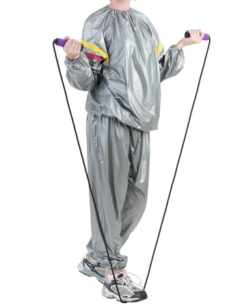 A woman in sauna suit with jumping rope