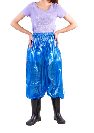 A woman wearing plastic trousers and boots for wet protection from rain or flood photo