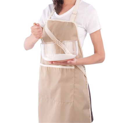 A housewife holding a glass bowl and stirring flour Stock Photo - 16894294