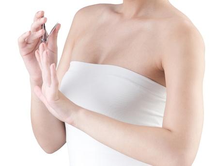 A woman cutting her fingernails photo