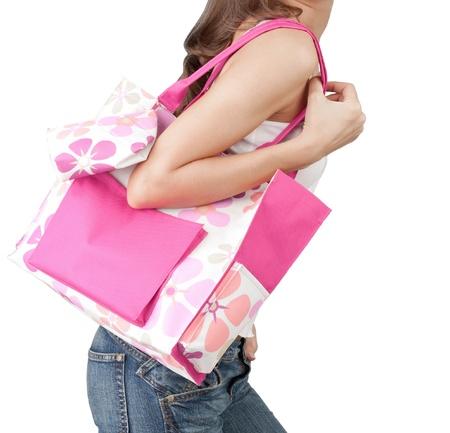 A woman carrying a pink handbag Archivio Fotografico