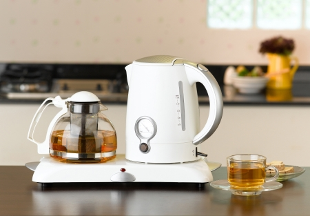 Electric kettle and glass pot for tea time or coffee time photo