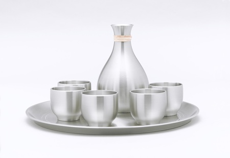 Tea pot and cups are on the tray which made of pewter