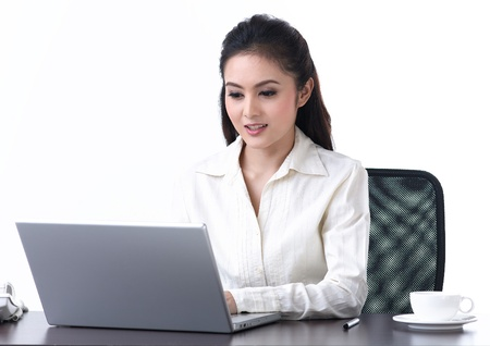 An asian business woman working with laptop Imagens